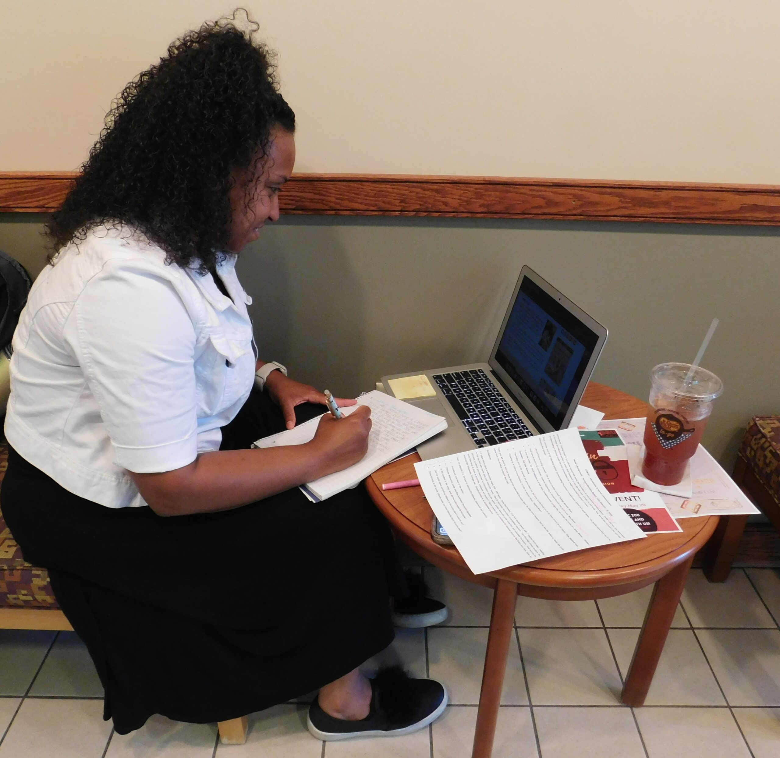 woman studying on laptop computer